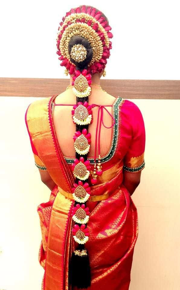 A bride wearing elaborate Jadanagam