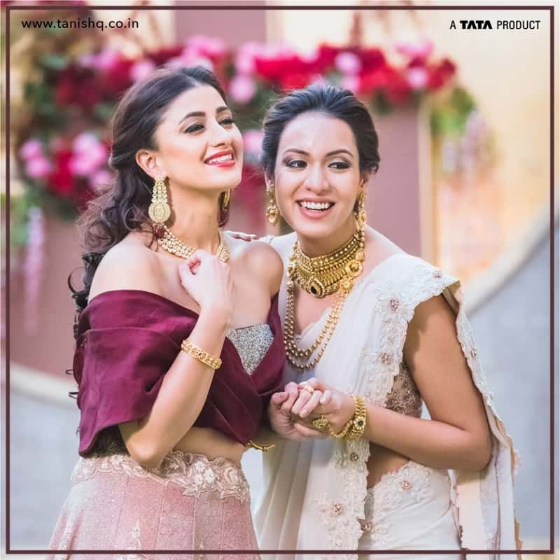 Models in Tanishq gold jewellery